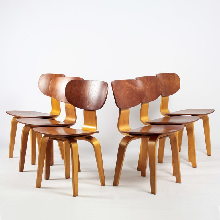 Beautiful set of 6 dining chairs designed by Cees Braakman for Pastoe. These SB13 Combex series chairs are made in bent teak and beech plywood.