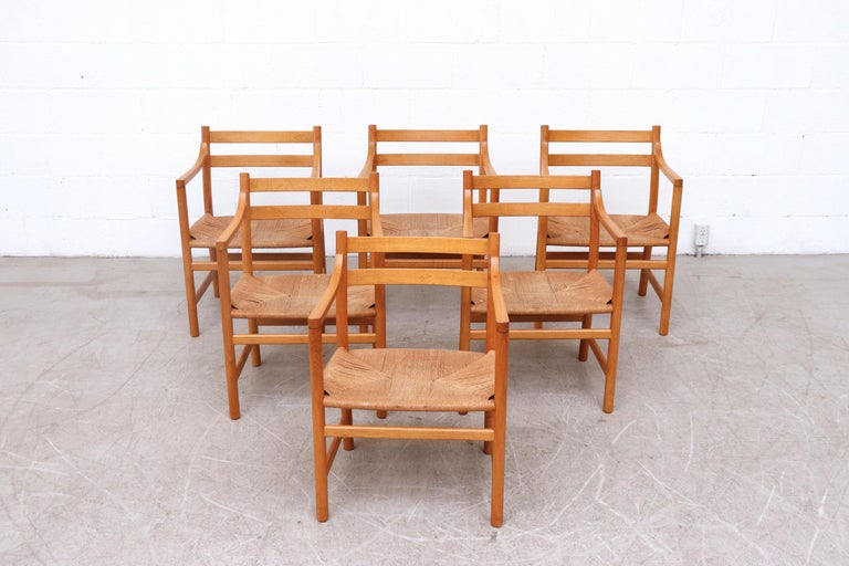 Set of 6 beautiful midcentury natural oak armchairs with paper cord seating. The 1965 design of the CH46 chair perfectly showcases Hans J. Wegner's Affinity for Functional, elegant simplicity. In original condition with minimal wear and loss.