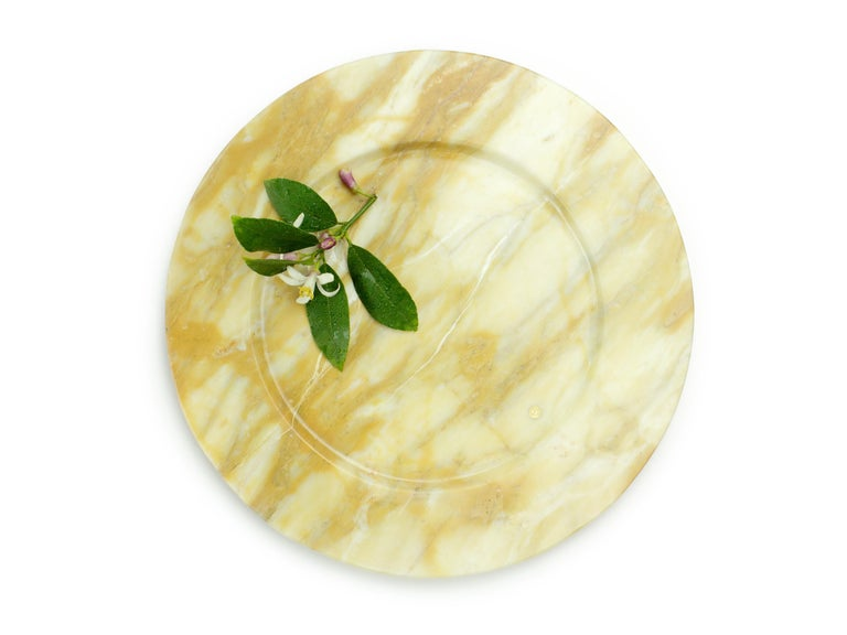 Set of 6 hand carved charger plates from Yellow Siena marble. Multiple use as charger plates, plates, platters and placers. Dimensions: D 33, H 1.9 cm.