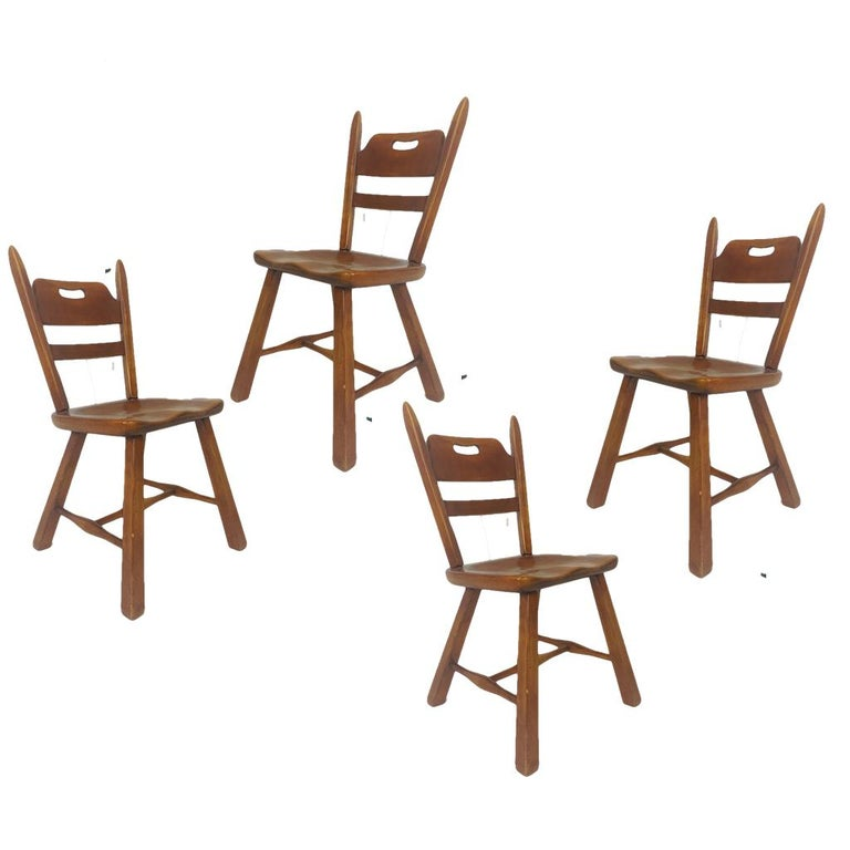 Set of 6 Vermont rock maple dining chairs designed by Herman DeVries for Cushman. Measures: armchairs: H 34 in. x W 22.75 in. x D 19 in. side chairs: H 34 in. x W 19 in. x D 18 in.
