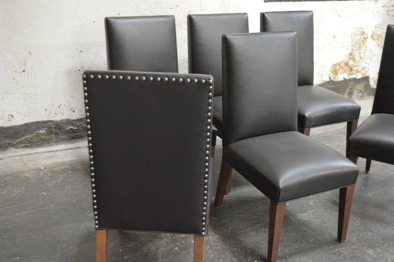 These custom Bjork Studio Vaughn dining chairs are ready for a dinner party. High end top grain chocolate brown leather and detailed with spaced zinc nail-heads along the outside back.