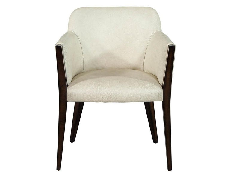Set of 6 custom modern leather dining chairs by Carrocel. Finished in a rich high gloss walnut color complimented by a beautifully textured taupe beige Italian leather. Custom options available per request.  Price includes complimentary curb side