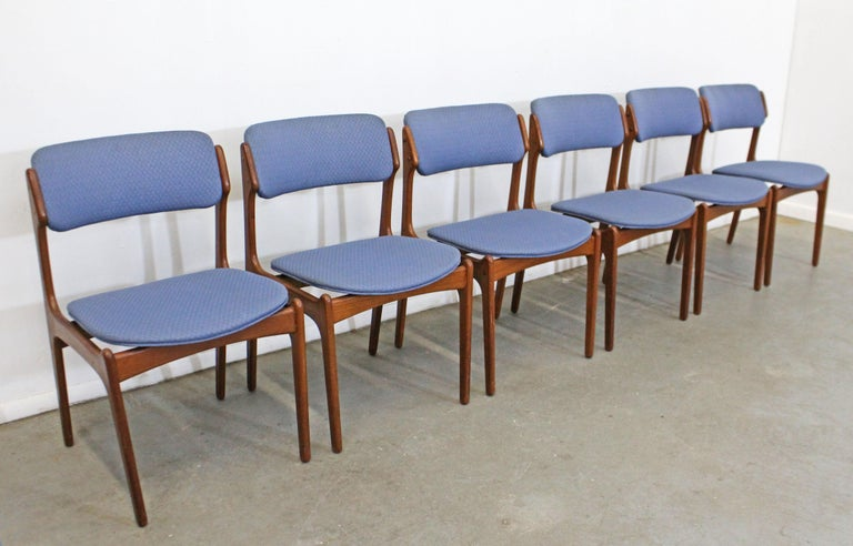 Offered is a vintage set of 6 Danish modern dining chairs, designed by Erik Buch for O.D. Mobler. These chairs have elegant lines and 'floating' seats with teak bases and upholstered seats/backs. They are in good vintage condition with some age wear