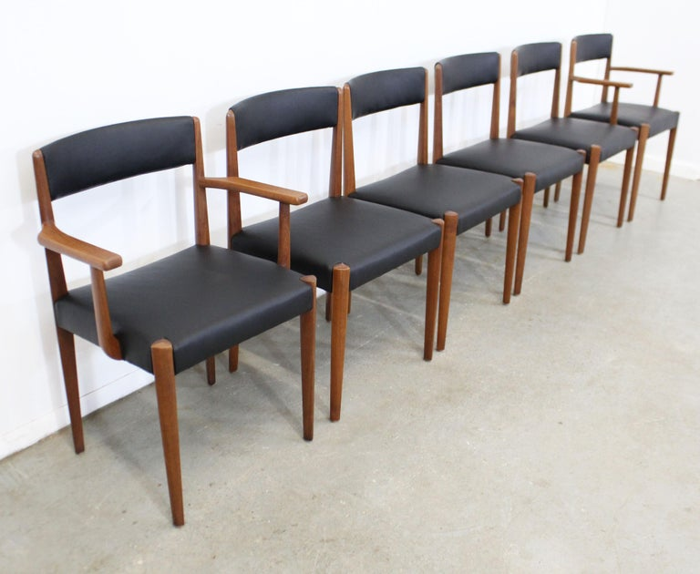 What a find. Offered is a restored vintage set of 6 rare, sleek Danish modern dining chairs. These chairs are made of teak, have been refinished and reupholstered in a supple black leather. They are in excellent restored condition, structurally