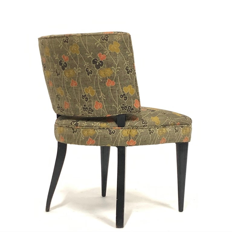 A generously proportioned set of six Gilbert Rohde for Herman Miller from the Paldao group with ebonized solid wood legs. The chairs are covered in a vintage silk fabric with an Asian motif that is serviceable. These chairs are fairly uncommon and
