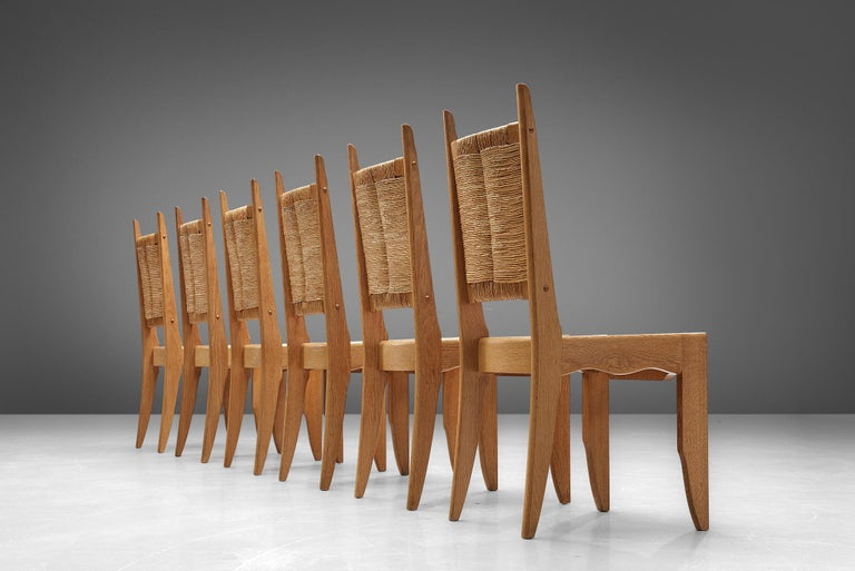 Guillerme & Chambron for Votre Maison, set of 6 dining chairs, solid oak and rush seating, France, 1960s.