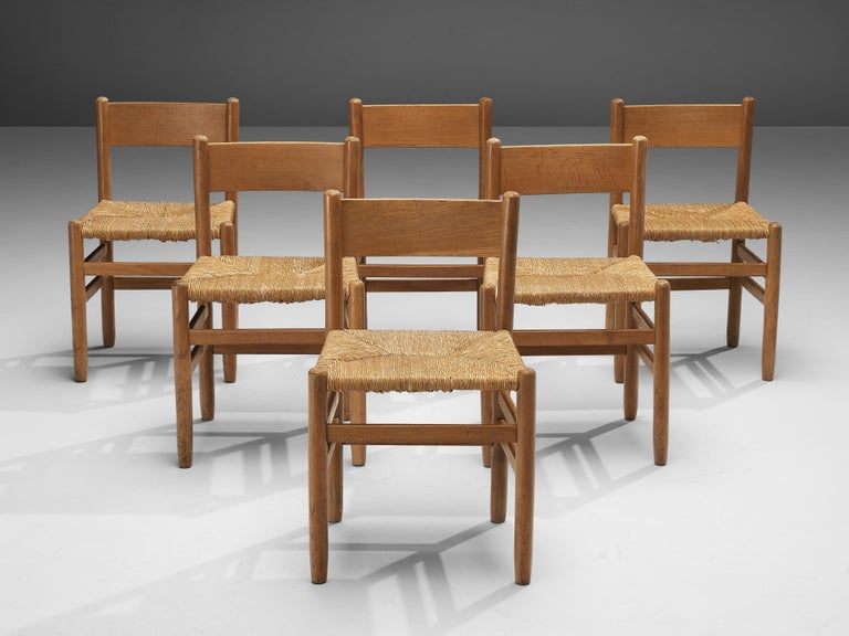 Dining chairs, oak, rush, Europe, 1960s  Set of dining chairs with a natural look. These chairs convince through their almost monochrome design. The combination of blond oak and rush seats in the same color tone, create a pleasing chair.