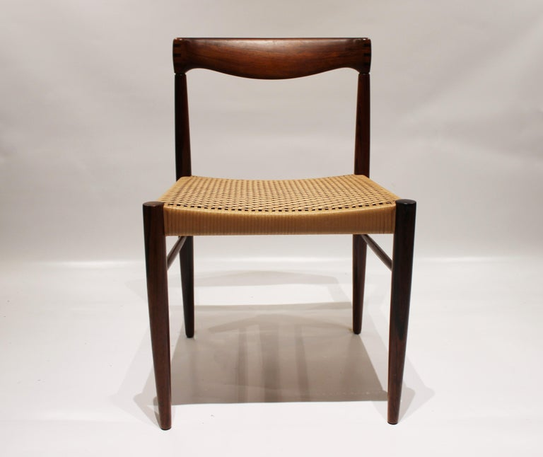 Set of 6 dining chairs in rosewood and papercord designed by H.W. Klein and manufactured by Bramin furniture factory in the 1960s. The chairs are in great vintage condition.