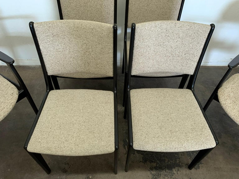 A wonderful set of 4 Erik Buch dining chairs with ebonized frames. Erik Buch's simple and clean Danish designs are timeless classics that never go out of style. These black, Danish modern chairs are effortlessly chic. We currently have them paired