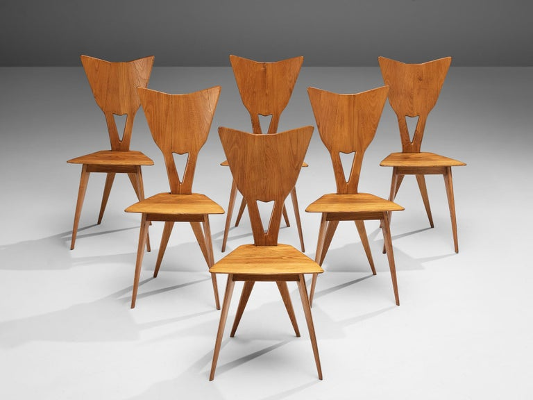 Set of 6 Italian chairs, stained ash, Italy, 1950s  Delicate set of 6 Italian chairs in stained ash. The beautiful natural grain of the ash wood contributes to the organic design. Based on the shape of a triangle, both the seat and the backrest