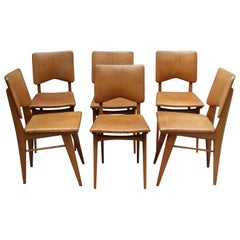 Set of 6 French 1950s Cherry and Leather Chairs by Jean Souvrain