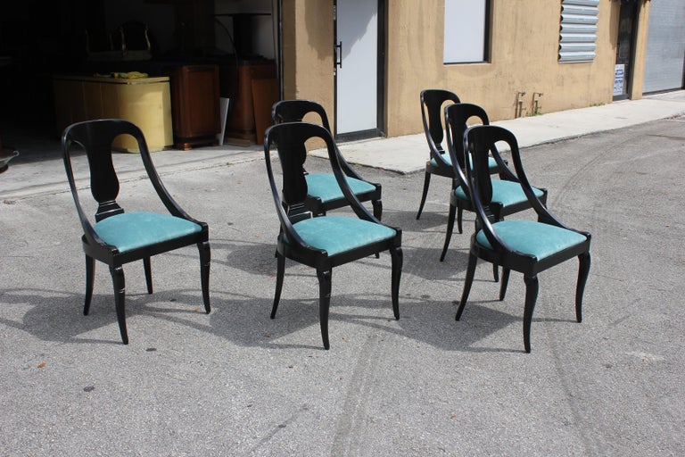 """Set of 6 French Art Deco """"Gondola"""" dining chairs, circa 1940s, made of mahogany, the mahogany wood has been ebonized and finished with a French polished high luster, The seats of 6 dining chairs have been newly upholstered in aqua blue, the chairs"""