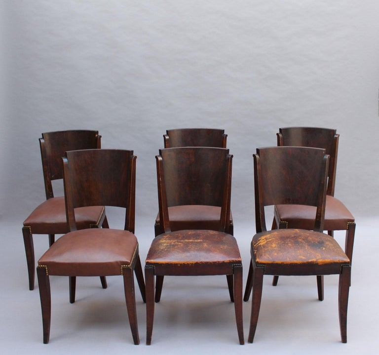 Set of 6 French 1940s dining chairs with a darkened wood frame and a palissander back.