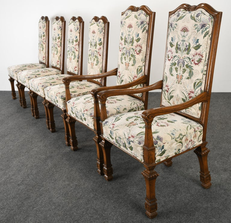A decorative set of six Louis XIV style dining chairs by Auffray & Co Furniture. The Louis XIV chairs have a square baluster leg and an arched back with shaped indents. These finely carved French chairs are sturdy and in good condition with