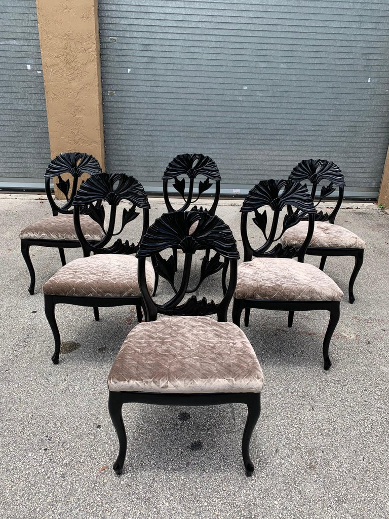 Set of 6 French Mid-Century Modern dining chairs circa 1960s, made of mahogany, the mahogany wood has been ebonized and finished with a French polished high luster, the seats of 6 dining chairs have been newly upholstered in beautiful champagne