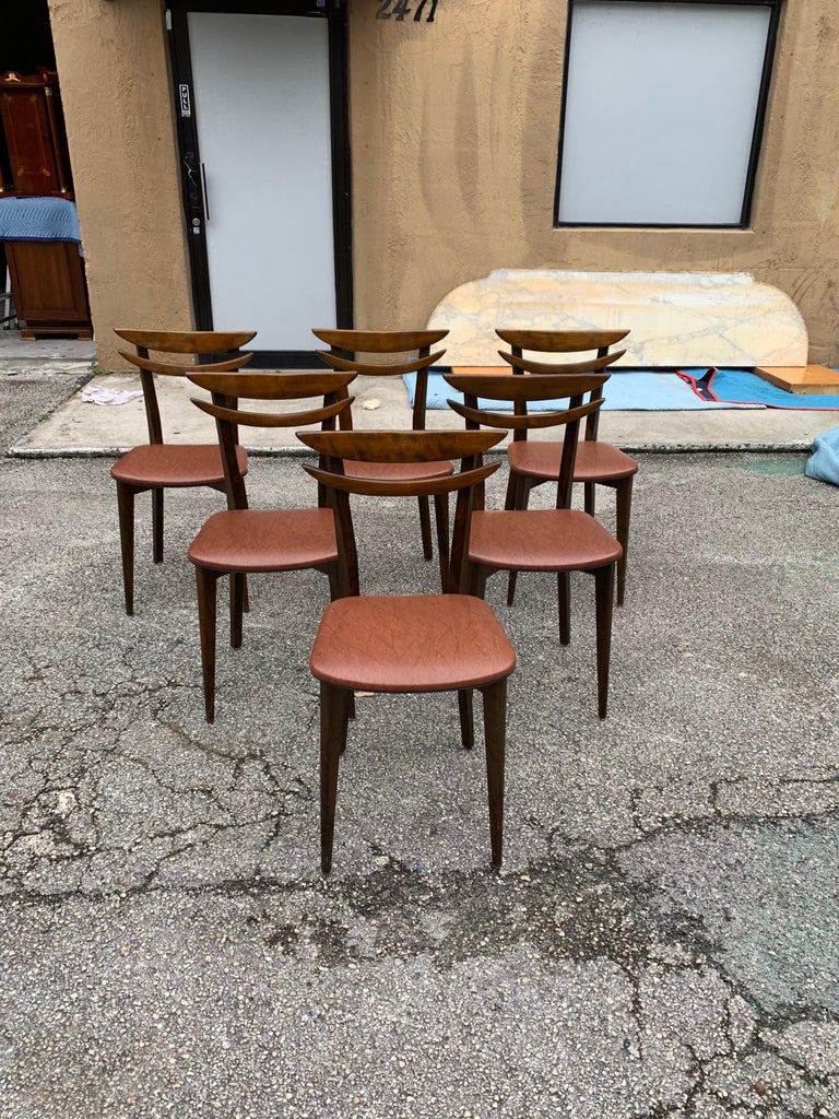 Classic set of six French Mid-Century Modern dining chairs solid mahogany, the chair frames are in excellent condition. The Reupholstery is vinyl and in very condition for all 6 dining chairs, the dining chairs are beautiful, circa 1950s.