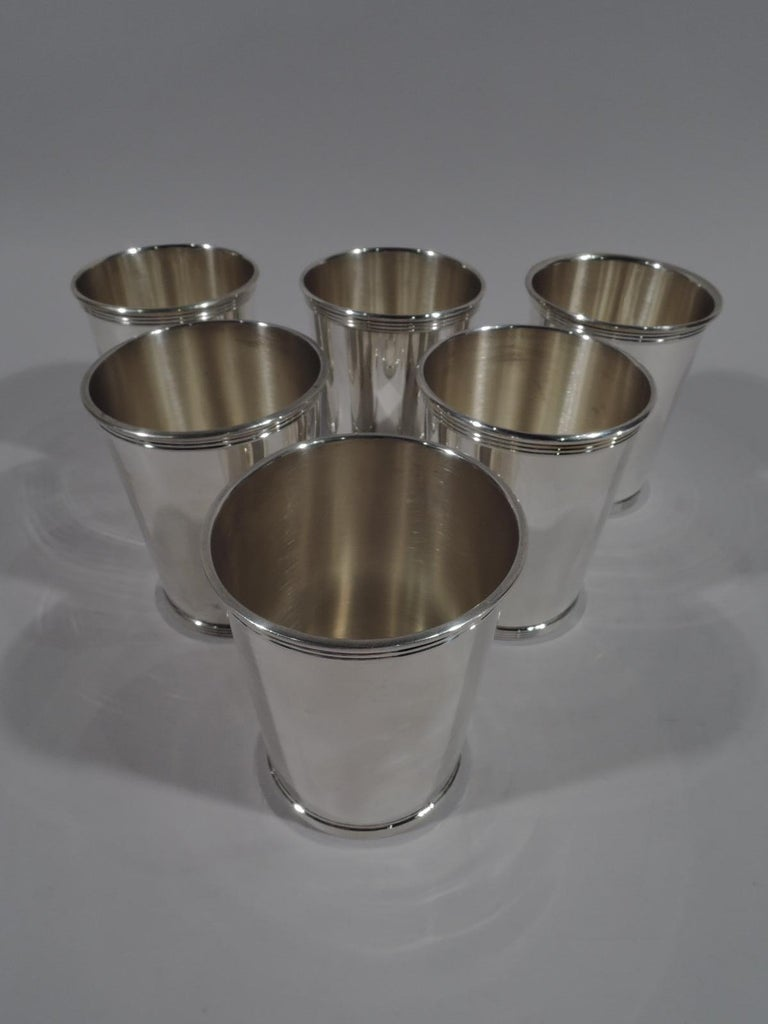 "Set of 6 sterling silver mint julep cups. Made by Gorham in Providence. Each: Straight and tapering sides, molded and reeded rim, and reeded foot. Marked ""Newport / Sterling 1673"". Newport was a Gorham brand. Total weight: 23 troy ounces."
