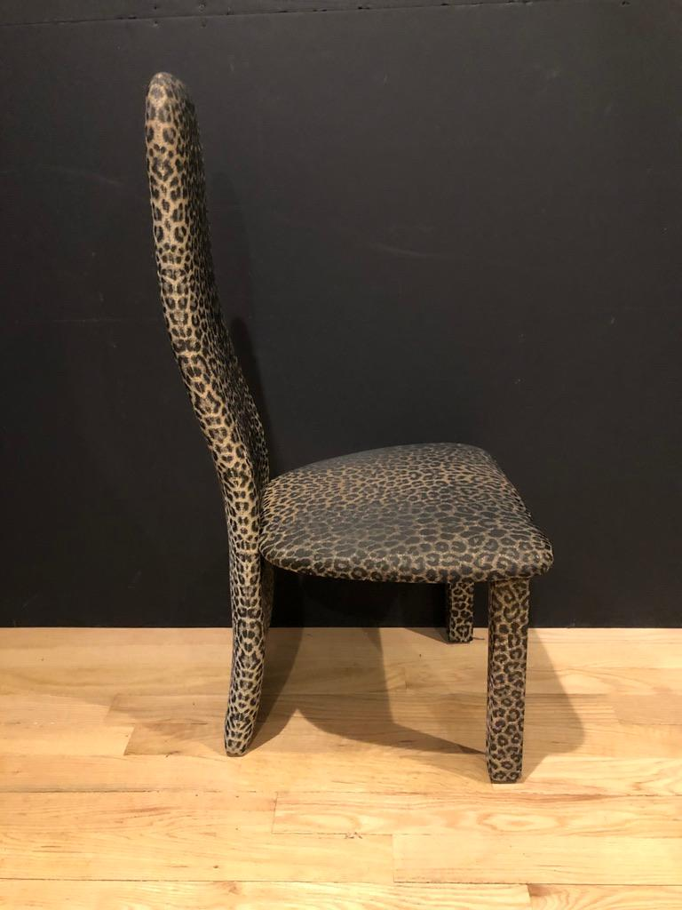 Set of six (6) leopard print high back contemporary dining chairs. A single plank forms both the backrest and acts as the back legs.