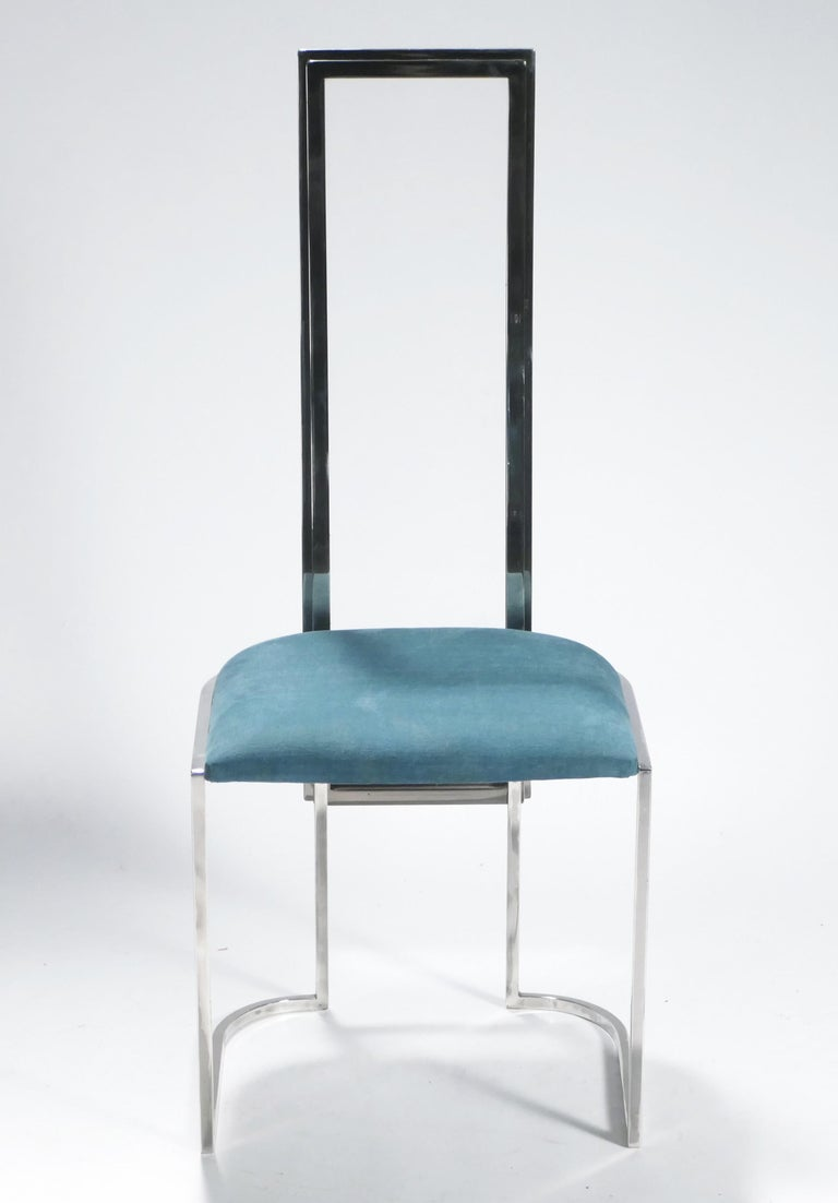 Shaped nickel metal and plexiglass Lucite form the base of these stylish Mid-Century Modern Italian chairs. The unmarred, shiny metal structure and brand-new teal upholstery in high-quality fabric mean this set has been maintained in very good