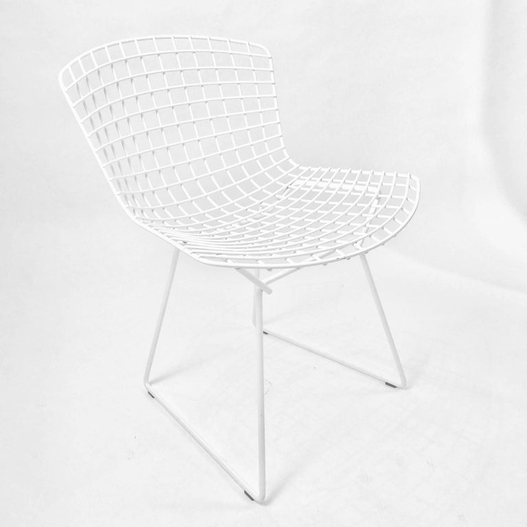 five iconic harry bertoia white powder coated side chairs stamped