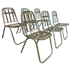 Set of 6 Industrial Riveted Iron Stacking Chairs, circa 1930