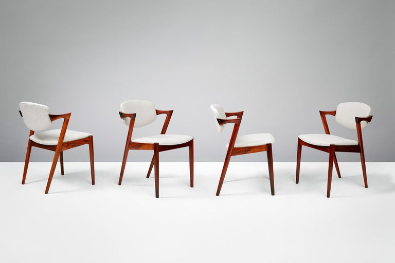 Kai Kristiansen  Model 42 dining chairs, 1956.  Set of 6 dining chairs produced by Skovman Andersen for the Illum Bolighus department store in Copenhagen. Refinished rosewood frames with seat and back reupholstered with Kvadrat Hallingdal wool