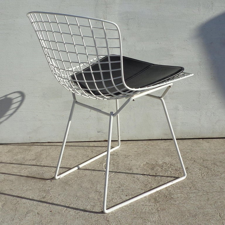 Set of 6 Knoll Bertoia side chairs  Harry Bertoia's 1950 experiment with bending metal rods into practical art produced a revered collection of seating, including the exquisite Bertoia side chair.    Welded steel with rods in a matte white finish.