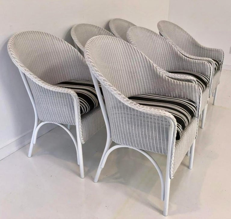 Add casual elegance to your dining experience with the 6 Lloyd Loom barrel back wicker woven armchairs with cushions. Chairs are 17 inches from floor to seat.