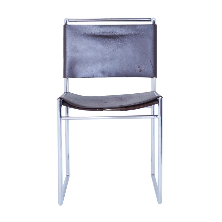 These Marcel Breuer armless corset chairs feature a chrome structure with a brown leather back and seat.  Since Schumacher was founded in 1889, our family-owned company has been synonymous with style, taste, and innovation. A passion for luxury
