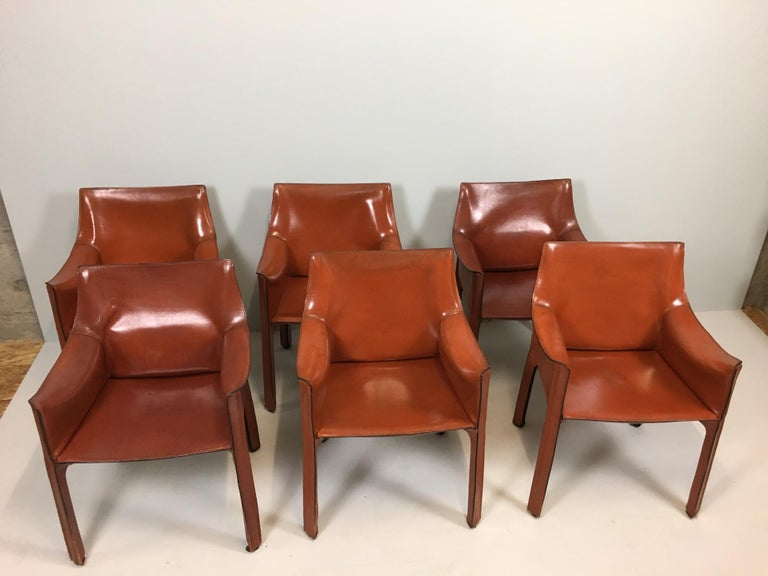 Set of 6 leather 413 Cab, by Mario Bellini, Cassina armchairs with enameled steel frame. Leather upholstery zippered over the frame.  Mario Bellini (born 1935) is trained as an architect and became one of the leading designers in postwar Italian