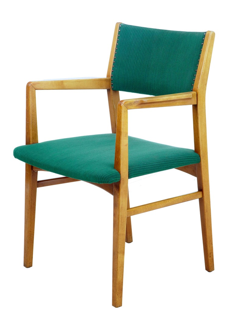 Set of 6 mid-20th century Scandinavian armchairs circa 1960.  Good quality set of Swedish office chairs which could now serve well as dining chairs. Very comfortable and made in solid beech. Upholstered in contrasting green fabric.  Surface
