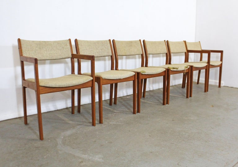 Offered is a vintage set of 6 teak dining chairs. Includes four side chairs and two armchairs, which need to be reupholstered. They have great bones, but need to be reupholstered (see photos). Still a great set with lots of potential. One chair may