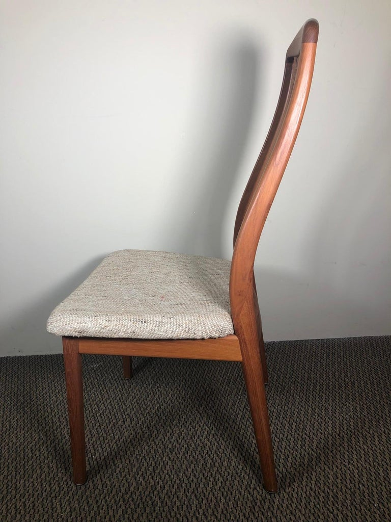 This is a set of 6 Danish teak dining chairs made by Dyrlund. Excellent vintage condition with only minor marks here and there from normal use. The upholstery appears to be original and could easily be changed to match your décor. Stamped 'Made