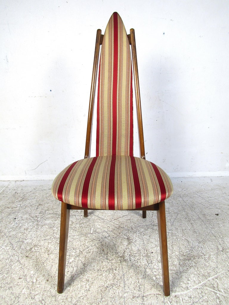 Beautiful set of 6 midcentury dining chairs attributed to Adrian Pearsall. High arched backs along with splayed legs give these chairs an interesting visual profile. This set would look great in any modern interior's dining room. Please confirm item