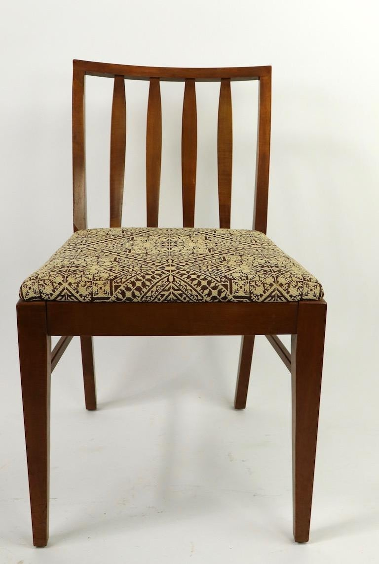 Stylish architectural set of dining chairs, of solid maple with upholstered seats consisting of 2 Armchairs, and 4 side chairs. Dimensions as follows: Armchairs 32 Total H x 25 arm H x 17 seat H x 20 depth x 23 W Side chairs 32 Total H x 17 seat H