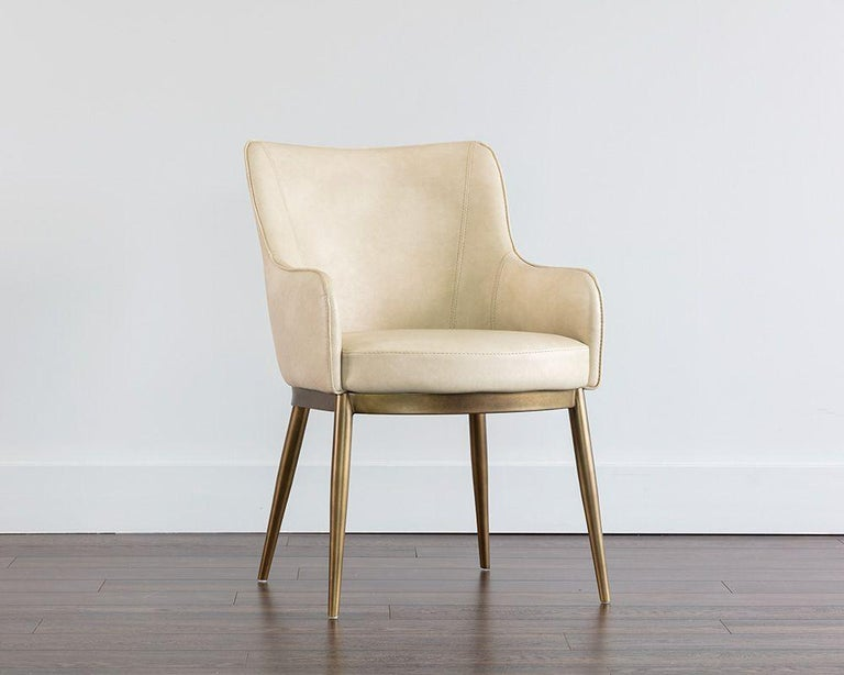 Compact with a semi-circular back, this set of 6 armed dining chairs feature a Mid-Century Modern touch and an ergonomic design.
