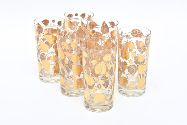 This Mid-Century Modern set of 6 signed Georges Briard highball glass/ barware are a pattern of applied gold painted overlay of leafs with detailed veining throughout the glass. These are from the 1960s and must be hand washed. They are not