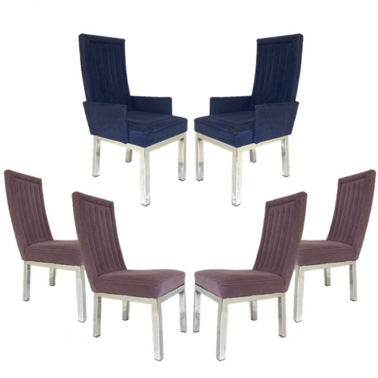 Lovely set of 6 Sleek Milo Baughman chrome based dining chairs. This set consists of 2 armchairs and 4 side chairs done in complimentary colors of ultra-suede.  Measures: Arm height on armchairs: 22