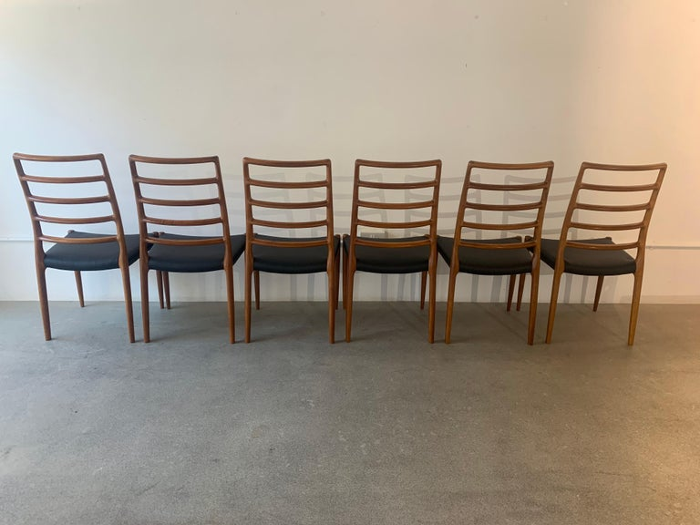 A wonderful set of 6 rare Danish model 82 teak dining chairs which are the taller five-rung ladder-back version designed by Niels O. Møller for J.L. Møllers Møbelfabrik. The Model 82 chairs are one of the rarer designs, most elegant and well