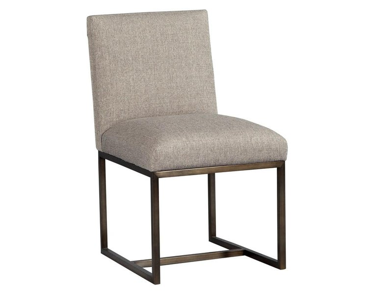 Demanding immediate attention, this fabulously designed modern chair is sure to add glam to any room. Upholstered in a sumptuous linen, with a pleated accent on the back, perched on a bronze colored stainless-steel base providing a solid foundation