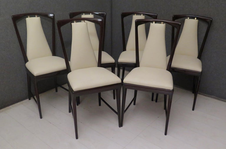 Innovative, for a design that is still contemporary today, I would dare to say an eternally brilliant shape. Precious mahogany wood material. In the true style of Osvaldo Borsani in the middle of the century.  The 6 chairs are made of a structure