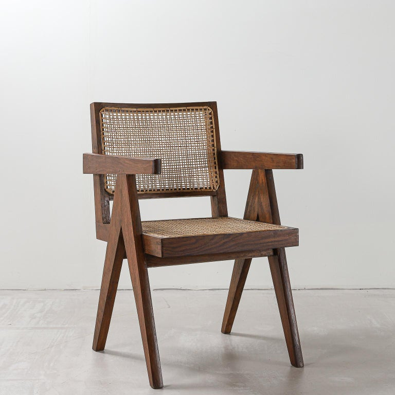 Pierre Jeanneret office chair, variant, circa 1953-1954. Model number PJ-SI-28-D  Teak and rattan. Intended for: various administrative buildings, Chandigarh, India.  Photos of original state to show authenticity available on request.   Pierre