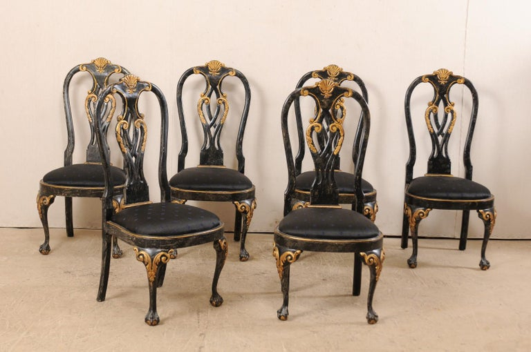 A set of six Portuguese style dining side chairs. This set of American side chairs, in Portuguese design, each feature nicely decorated backs with shell centered rocaille at top rail, above a pierced splat back. Front knees are emphasized with
