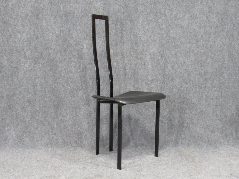 Set of six (6) Italian 1980s Postmodern black metal dining chairs (Model Carre VI) made by Cattelan Italia with black leather seats. Great sculptural design by Maurizio Cattelan who is known best for his hyper realistic sculptures and installations