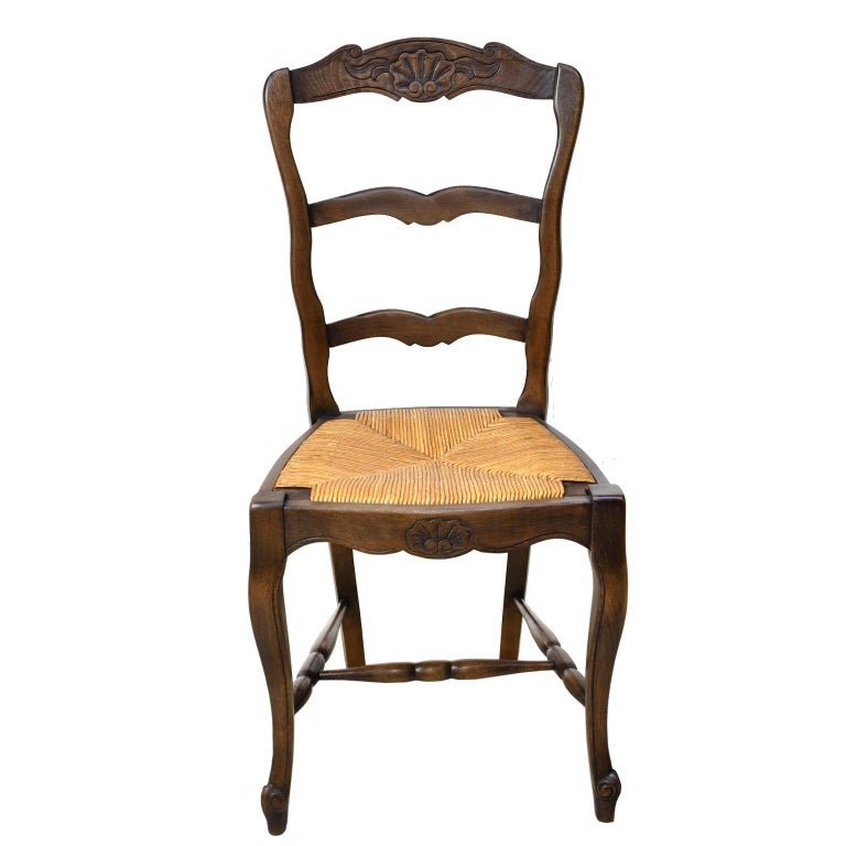 A very nice set of early 20th century French Provincial style ladder back chairs in a walnut finish with removable rush seats. All chairs are in very good condition, they have been restored and waxed. High backs are particularly