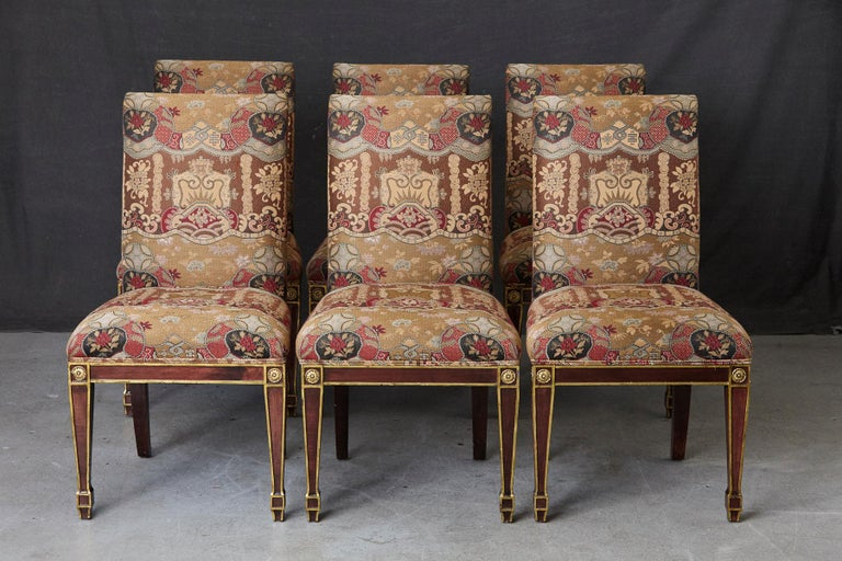 Set of 6 Regency style dining chairs with painted gilt elements and medallions.