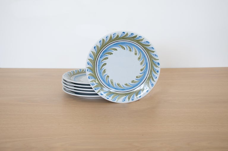 Incredible set of 6 painted plates by Roger Capron from France, 1950s. Beautiful hand painted blue and green leaf motif on slightly tinted blue ceramic plate. Signed on back.