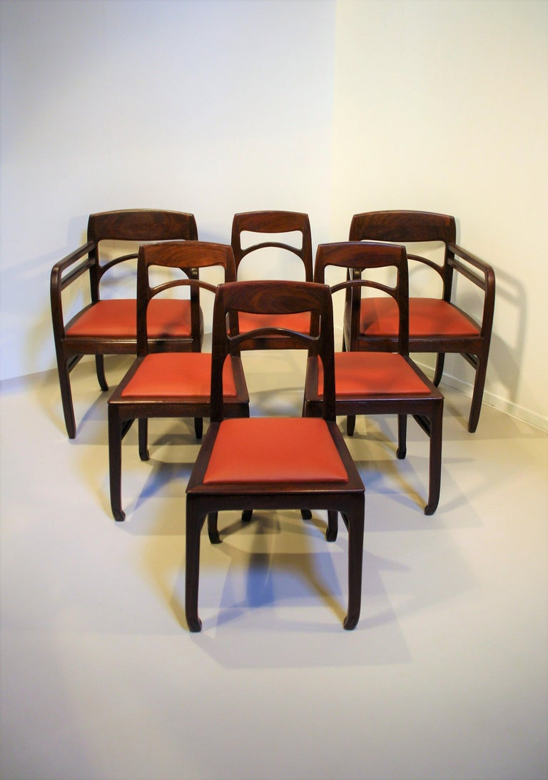 A complete set of six Richard Riemerschmid (1868-1957) rosewood chairs consisting of four dining room chairs and two armchairs. What so special is that this set is complete and made from solid Rosewood from Rio. The chairs are in a very good