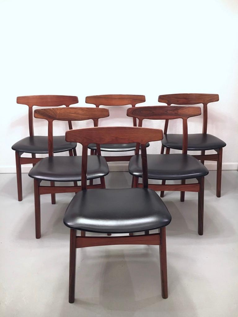 Vintage set of 6 Rio rosewood and black faux leather dining chairs by Henning Kjaernulf produced by Bruno Hansen, Denmark, circa 1960 Very good original condition. Very comfortable. Stamped under the seat.