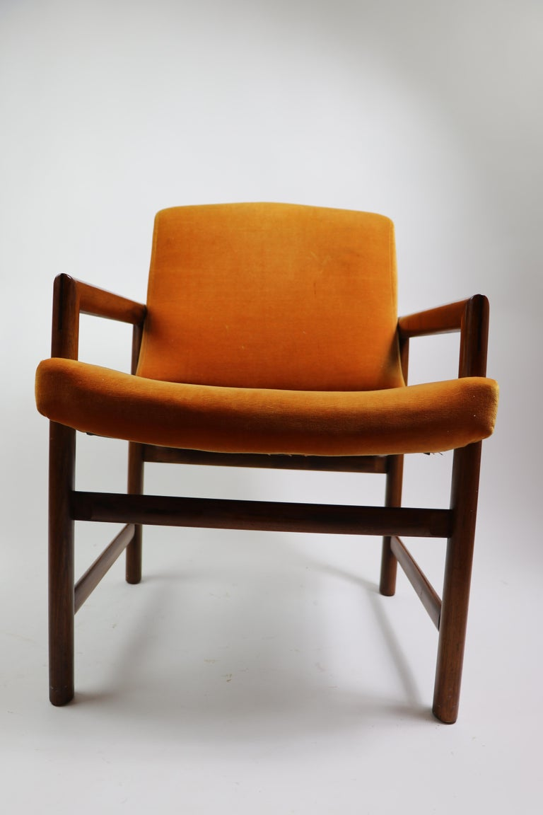 Beautiful and rare set of 6 dining chairs, designed by Milo Baughman. Six armchairs each with upholstered backs and seats (upholstery as is) . Sophisticated architectural structure, comfortable, and stylish set of dining chairs. Measures: Arm H 23